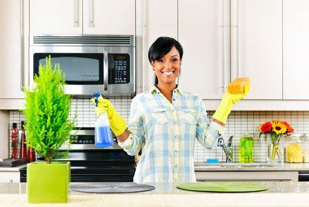 Happy-woman-cleaning-kitchen-horiz Mc9ucj