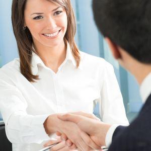 Cheerful businesspeople handshaking
